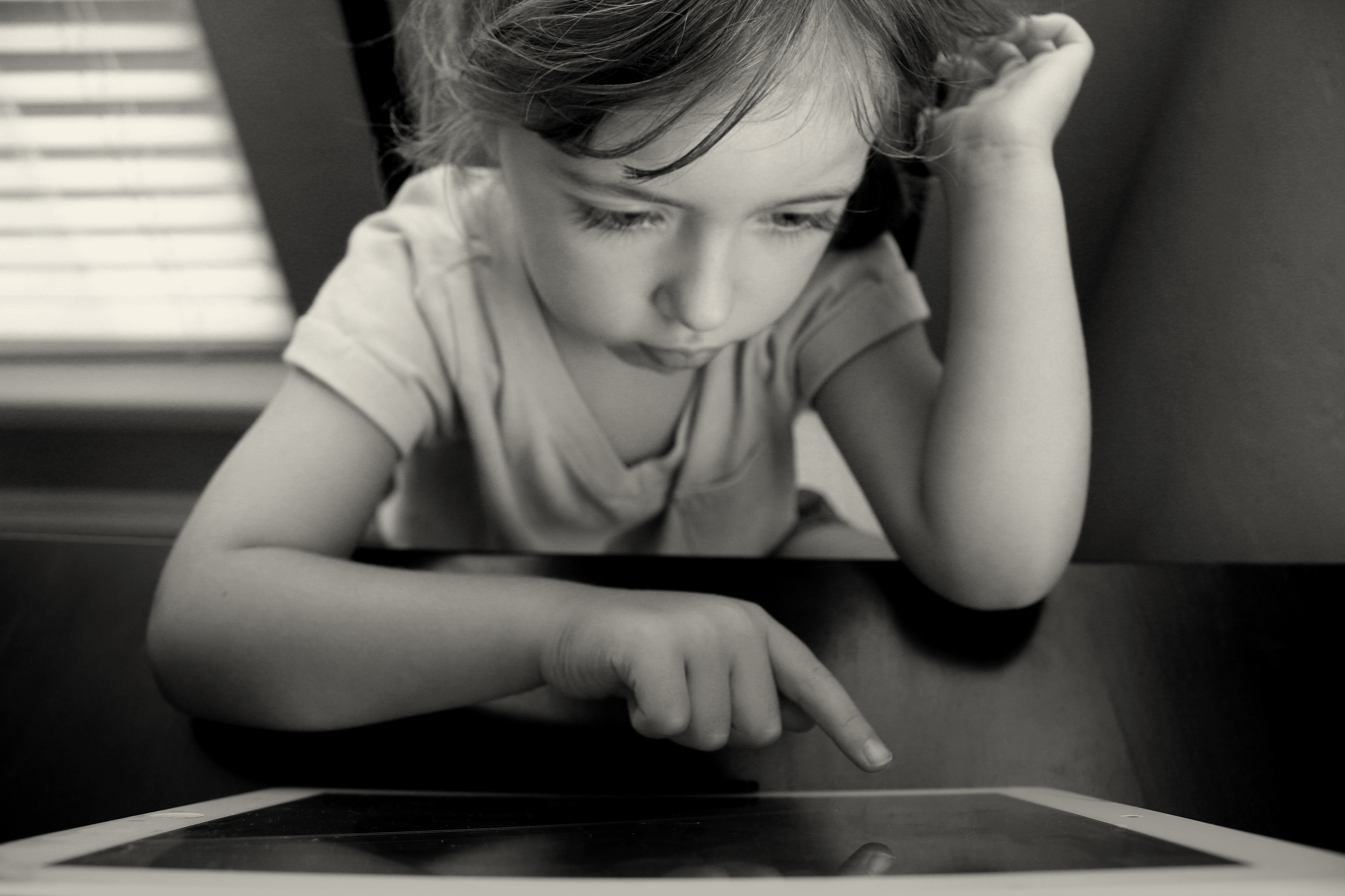 Child using a tablet for distance learning