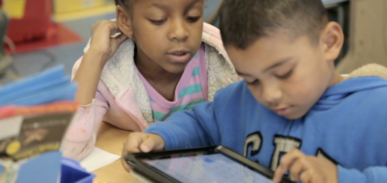 Students using Imagine Language & Literacy on a tablet